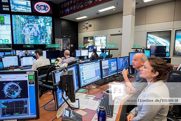 Flight Director Brian Smith  Capcom Astronaut Jessica Meir along with Astronaut Jeff Williams monitor activities in Mission Control as President Donald Trump  First Daughter Ivanka Trump and NASA astronaut Kate Rubins make a special Earth-to-space call from the Oval Office to personally congratulate NASA astronaut Peggy Whitson for her record-breaking stay aboard the International Space Station. (Photo Credit: NASARobert Markowitz)