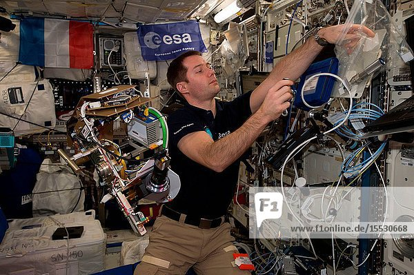 Astronaut Thomas Pesquet  of the European Space Agency (ESA)  is at work inside the Columbus laboratory module developed by ESA.