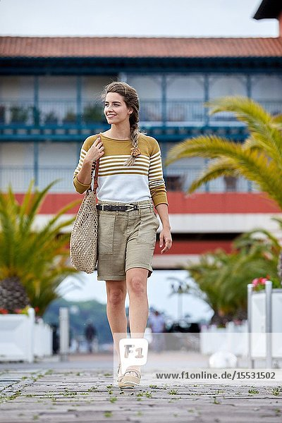 Woman walking near the harbour  Sokoburu  Hendaye  Aquitaine  Basque Country  France