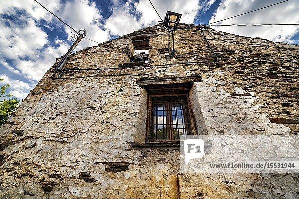 Window  bell and lamppot on old hermitage at El Espinar. Guadalajara. Spain. Europe.
