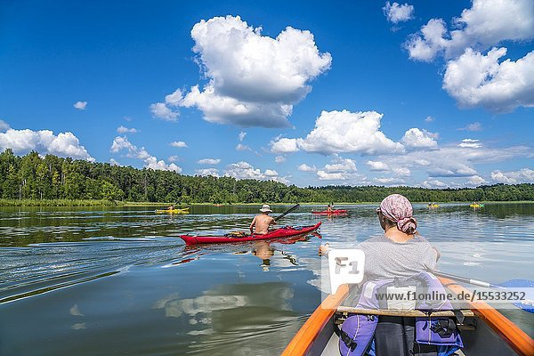 Canoe and kayaks on the Wet Lake Jezioro MokreL  UNESCO biosphere reserve Masurian Lakes near Krutyn  Warmian-Masurian  Poland  Europe.