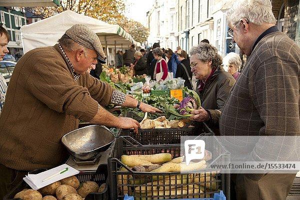 A woman buying fresh locally grown vegetables at Aberystwyth Farmers Market  November 6 2010