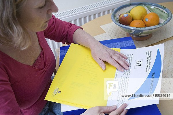Woman looking at her houses energy rating certificate