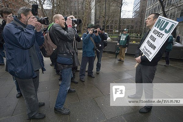 NUJ General Secretary Jeremy Dear was photographed by around 20 photographers as he made a lone demonstration for media freedom at New Scotland Yard Mar 2008