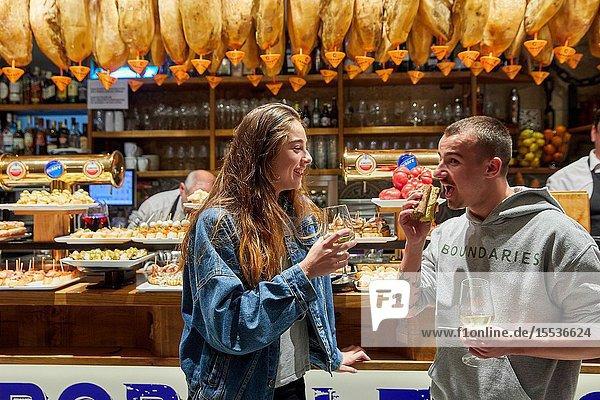 Young couple eating 'Pintxos' at the Meson Portaletas  Parte Vieja  Old town  Donostia  San Sebastian  Gipuzkoa  Basque Country  Spain