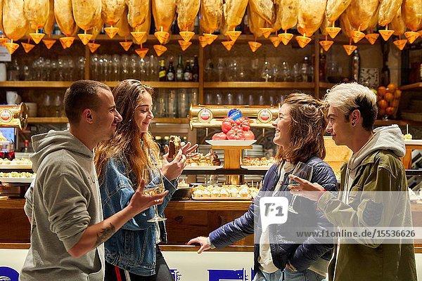 Group of young people eating 'Pintxos' at the Meson Portaletas  Parte Vieja  Old town  Donostia  San Sebastian  Gipuzkoa  Basque Country  Spain