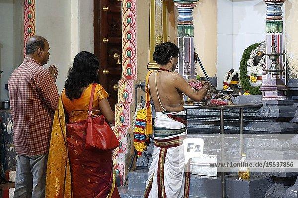 Puja. Traditional Hindu Ceremony. Sri Mariamman Hindu temple. Singapore.