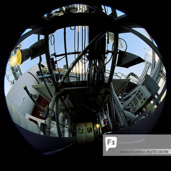 A photographer used a fish-eye lens attached to an electronic still camera to record a series of photos of the Space Shuttle Discovery at the launch pad while the STS-120 crew was at Kennedy Space Center for the Terminal Countdown Demonstration Test in October 2007.