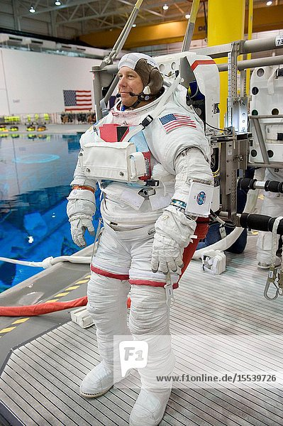 NASA astronaut Tim Kopra  STS-133 mission specialist  attired in a training version of his Extravehicular Mobility Unit (EMU) spacesuit  awaits the start of a spacewalk training session in the waters of the Neutral Buoyancy Laboratory (NBL) near NASA's Johnson Space Center.