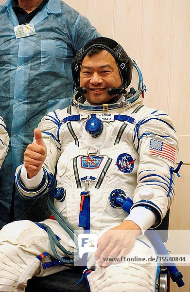 Astronaut Leroy Chiao  Expedition 10 commander and NASA International Space Station (ISS) science officer  donned his launch and entry suit and climbed aboard the Soyuz TMA-5 spacecraft October 5  2004  at the Baikonur Cosmodrome in Kazakhstan for a dress rehearsal of launch day activities leading to their liftoff October 14 to the ISS. Chiao and cosmonaut Salizhan S. Sharipov  Russia's Federal Space Agency Expedition 10 flight engineer and Soyuz commander  the first crew of all-Asian extraction  will spend six months on the Station  while Russian Space Forces Cosmonaut Yuri Shargin will return to Earth October 23 (U.S.A. time) with cosmonaut Gennady I. Padalka  Expedition 9 commander  and astronaut Edward M. (Mike) Fincke  NASA ISS science officer and flight engineer  who have been in space since April. Photo Credit: NASABill Ingalls
