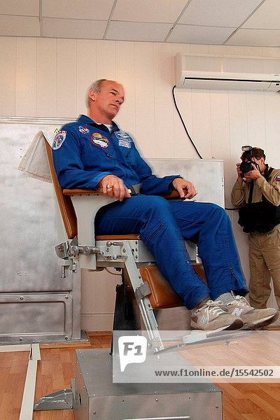 At his crew quarters in Baikonur  Kazakhstan  NASA astronaut Jeff Williams  Expedition 21 flight engineer  received prelaunch physical conditioning in a rotating chair Sept. 24  2009 as he prepares for liftoff to the International Space Station on September 30 with Russian cosmonaut Max Suraev  Soyuz Commander  and spaceflight participant Guy Laliberte in their Soyuz TMA-16 spacecraft. Photo credit: NASAVictor Zelentsov