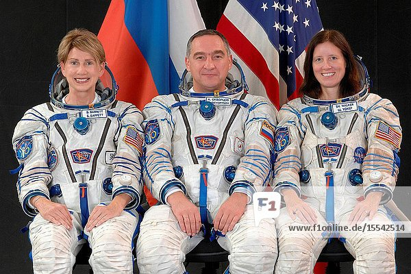 Attired in Russian Sokol launch and entry suits  backup spaceflight participant Barbara Barrett (left)  Russian cosmonaut Alexander Skvortsov  backup Soyuz commander and Expedition 21 flight engineer  and NASA astronaut Shannon Walker  backup Expedition 21 commander and flight engineer  take a break from training in Star City  Russia to pose for a portrait. Photo credit: Gagarin Cosmonaut Training Center
