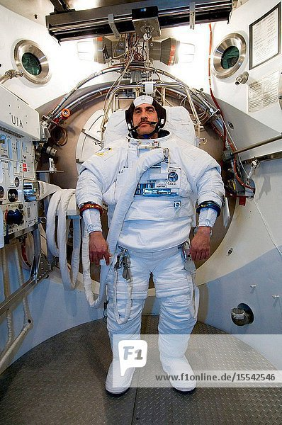 Cosmonaut Pavel V. Vinogradov  Expedition 13 commander representing the Russian Federal Space Agency  participates in an Extravehicular Mobility Unit (EMU) spacesuit fit check in the Space Station Airlock Test Article (SSATA) in the Crew Systems Laboratory at the Johnson Space Center.