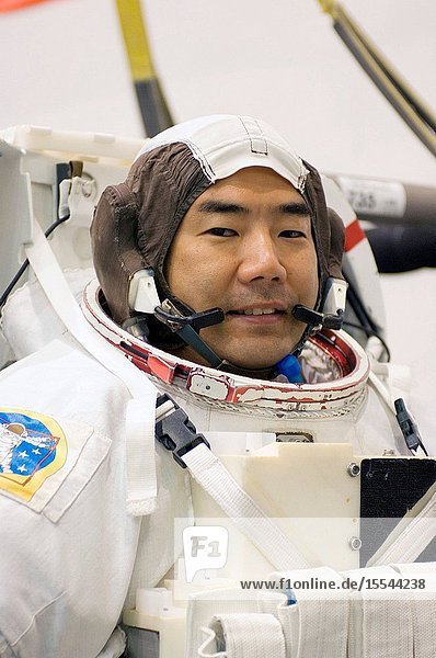 Japan Aerospace Exploration Agency astronaut Soichi Noguchi  Expedition 2223 flight engineer  awaits the start of a training session in the waters of the Neutral Buoyancy Laboratory (NBL) near NASA's Johnson Space Center. Noguchi is wearing a training version of his Extravehicular Mobility Unit (EMU) spacesuit.
