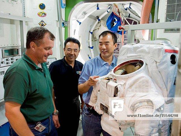 NASA astronaut T.J. Creamer (left) and Japan Aerospace Exploration Agency (JAXA) astronaut Soichi Noguchi (right)  both Expedition 2223 flight engineers  along with JAXA astronaut Satoshi Furukawa  participate in a training session in the Space Vehicle Mock-up Facility at NASA's Johnson Space Center.
