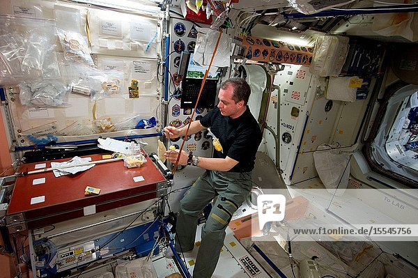 NASA astronaut T.J. Creamer  Expedition 23 flight engineer  eats a snack at the galley in the Unity node of the International Space Station.