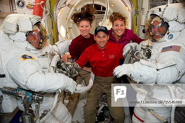 NASA astronauts Clayton Anderson (left) and Rick Mastracchio  both STS-131 mission specialists  attired in their Extravehicular Mobility Unit (EMU) spacesuits  along with astronauts Tracy Caldwell Dyson (center left)  Expedition 23 flight engineer  James P. Dutton Jr.  STS-131 pilot  and Dorothy Metcalf-Lindenburger  mission specialist  pose for a photo in the Quest airlock of the International Space Station prior to the start of the mission's second spacewalk.
