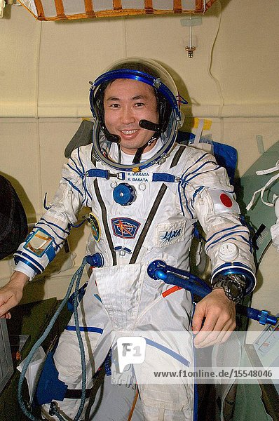 Japan Aerospace Exploration Agency (JAXA) astronaut Koichi Wakata  Expedition 20 flight engineer  attired in a Russian Sokol launch and entry suit  is pictured in the orbital module of the Soyuz TMA-14 spacecraft following the relocation of the Soyuz from the Zvezda Service Module's aft port to the Pirs Docking Compartment of the International Space Station.