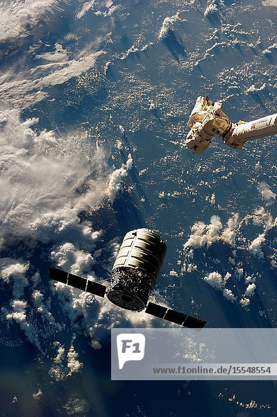 The Canadarm2 moves toward the first Cygnus commercial cargo spacecraft built by Orbital Sciences Corp. as it approaches the International Space Station. The two spacecraft converged at 7:01 a.m. EDT on Sept. 29  2013.