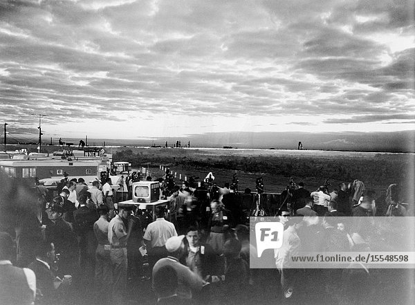 During the early hours of dawn  newsmen  photographers and T.V. reporters await the Mercury-Atlas 6 (MA-6) liftoff at Cape Canaveral  Florida.