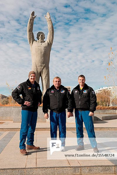 The Expedition 3839 backup crew members pose for pictures in front of a statue of Yuri Gagarin  the first human to fly in space  during a tour of the city of Baikonur  Kazakhstan Oct. 27. Alexander Gerst of the European Space Agency (left)  Russian cosmonaut Max Suraev (center) and Reid Wiseman of NASA are understudies to the prime crew  Koichi Wakata of the Japan Aerospace Exploration Agency  Soyuz Commander Mikhail Tyurin and Rick Mastracchio of NASA  who are scheduled to launch Nov. 7  Kazakh time  in the Soyuz TMA-11M spacecraft from Baikonur to begin a six-month mission on the International Space Station.Victor Zelentsov