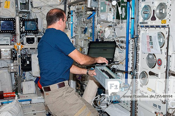 NASA astronaut Rick Mastracchio  Expedition 38 flight engineer  works with Biolab hardware in the Columbus laboratory of the International Space Station. Biolab is used to perform space biology experiments on microorganisms  cells  tissue cultures  plants and small invertebrates.