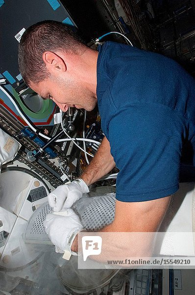 A specimen of human blood or a body fluid like saliva and urine is stowed by astronaut Michael Hopkins onboard the International Space Station on Oct. 5  2013. The objects of post-mission research by scientists on the ground  all the various aforementioned biological samples have to be frozen until the return to Earth.