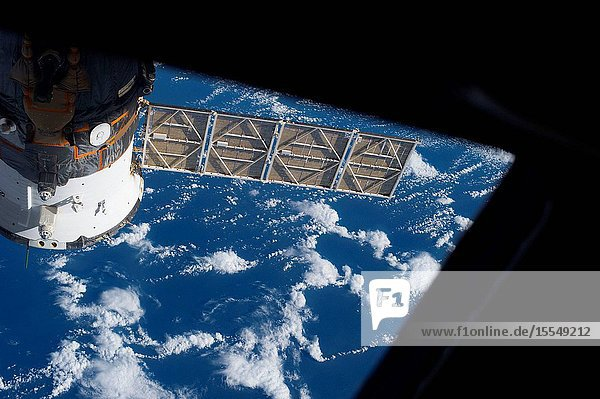 One of the Expedition 37 crew members on Oct. 3 exposed this frame showing a Russian Soyuz vehicle docked to the International Space Station against a backdrop of a blue and white Earth.