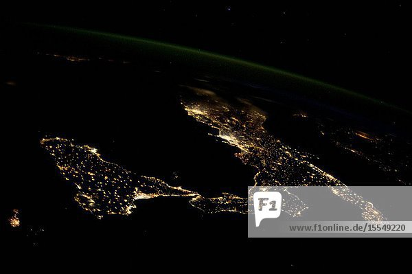 This night image of most of Italy and all of Sicily was photographed by one of the Expedition 37 crew members aboard the International Space Station flying approximately 240 miles above Earth on Oct. 23  2013. The night lights of Rome and Naples are visible near the center of the frame. Many other major cities are also visible by their lights. The Adriatic Sea is on the east (right) side of Italy.
