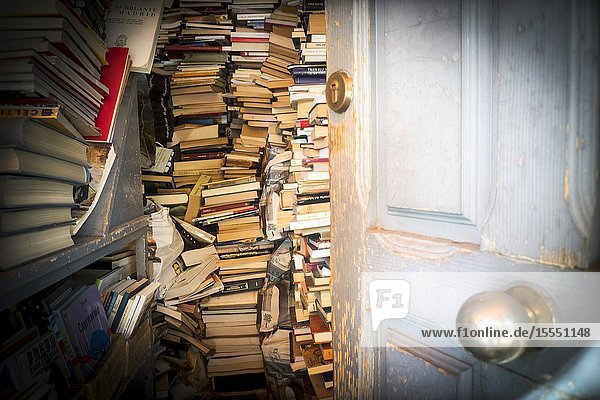Books piled in a house room. Madrid  Spain  Europe.
