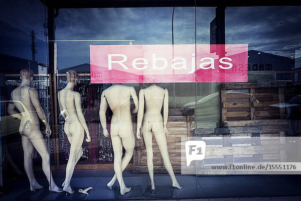 Back View of naked mannequins in the shop window with the sign Retail. Mahon  Balearic Islands  Spain  Europe.