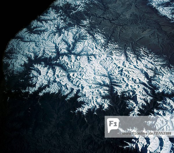 View of the Himalaya Mountain Range in the India-Nepal-Tibet border area  as photographed from the Mercury-Atlas 9 capsule by astronaut L. Gordon Cooper Jr.  during his 22-orbit MA-9 spaceflight.