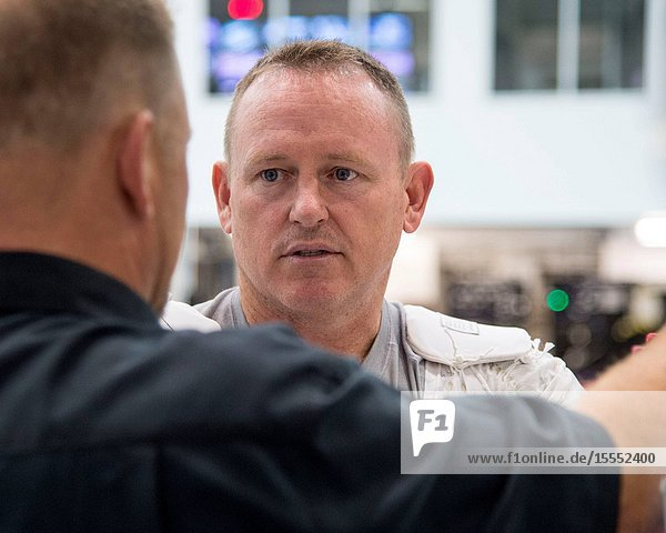 NASA astronaut Barry Wilmore  Expedition 41 flight engineer and Expedition 42 commander  is pictured during preparations for a spacewalk training session in the waters of the Neutral Buoyancy Laboratory (NBL) near NASA's Johnson Space Center.