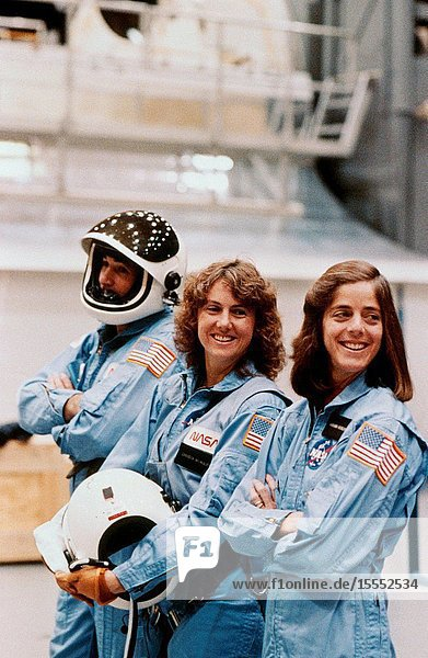 Payload specialists in training for STS-51L take a break in shuttle emergency egress training at the Johnson Space Center's (JSC) Shuttle Mock-up and Integration Laboratory. Left to right are Gregory Jarvis of Hughes  Sharon Christa McAuliffe and Barbara Morgan of the Teacher-in-Space Project. McAuliffe was selected as NASA's first citizen observer in the Space Shuttle Program and Morgan was named her backup. The photo was taken by Keith Meyers of the New York Times. (NOTE: The 51-L crew members lost their lives in the space shuttle Challenger accident moments after launch on Jan. 28  1986 from the Kennedy Space Center.) Photo credit: NASA.