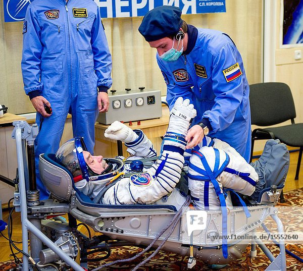 Expedition 38 Soyuz Commander Mikhail Tyurin of Roscosmos is seen laying in a seat liner as he and fellow crew mates  Flight Engineer Koichi Wakata of the Japan Aerospace Exploration Agency and Flight Engineer Rick Mastracchio of NASA  have their Russian Sokol suits pressure checked a few hours ahead of their launch  Nov. 7  2013  in Baikonur  Kazakhstan. Tyurin  Wakata and Mastracchio will launch in their Soyuz TMA-11M spacecraft to the International Space Station to begin a six-month mission.GCTCIrina Peshkova