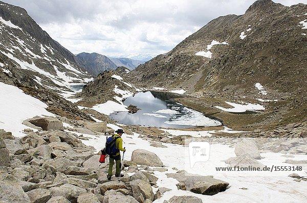 Mountaineer ascending to the peak of Vallibierna  Huesca  Aragon  Spain