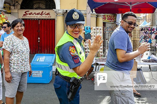 A Policewoman Dances In The Street With Festival Revellers During The Dinagyang Festival  Iloilo City  Panay Island  The Philippines.