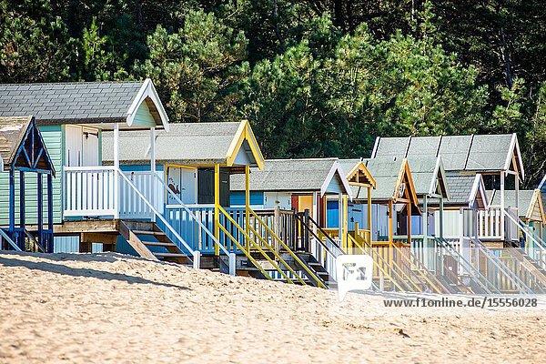 Colourful beach huts on Wells beach at Wells next the Sea on North Norfolk coast  East Anglia  England  UK.