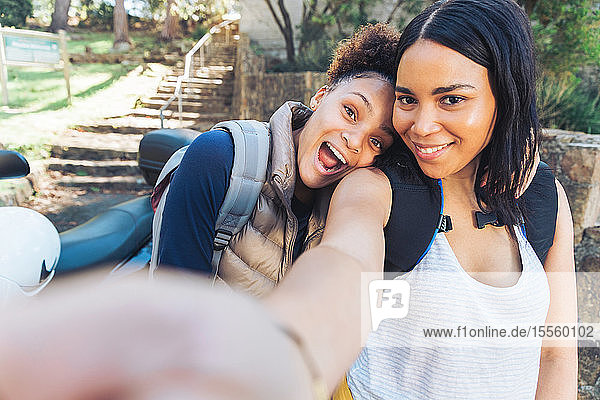 Selfie point of view happy  playful young women friends