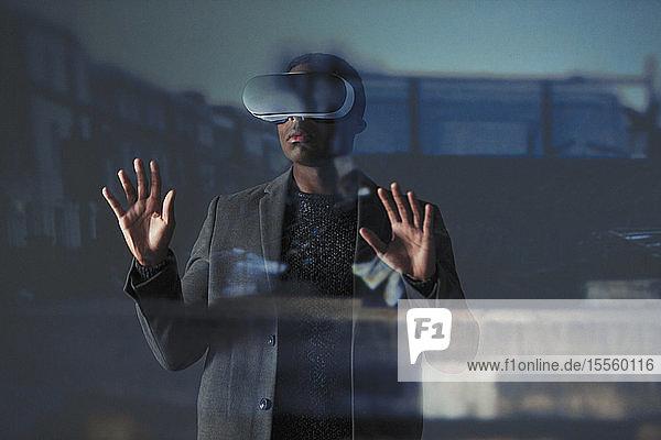Double exposure businessman using virtual reality simulator glasses