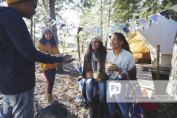 Lesbian couple with kids at campsite