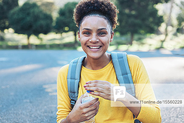 Portrait happy  confident young woman with water bottle