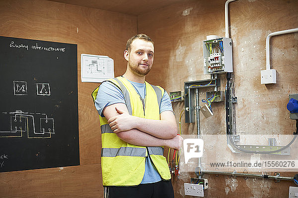 Portrait confident male electrician student