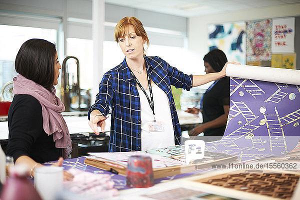 Women screen printing in art studio