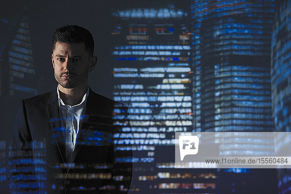 Double exposure determined businessman against highrise lights at night