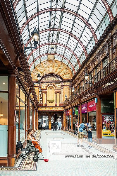 Female busker playing Chello in The Central Arcade in Newcastle upon Tyne  England  UK. Central Arcade is an Edwardian shopping arcade built in 1906.