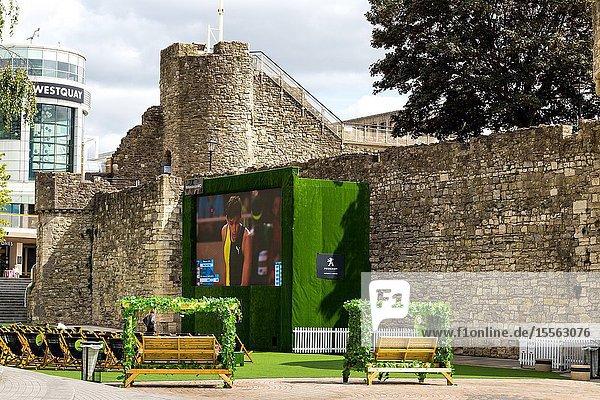 Spectators viewing Wimbledon tennis at open public area at westquay southampton England UK.