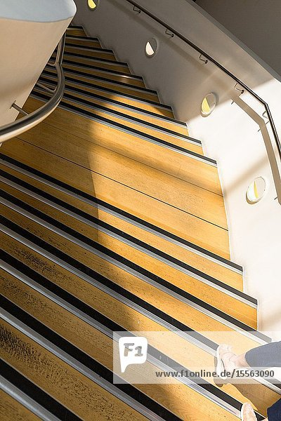 Feet. Interior spiral staircase. Museum of Liverpool. England UK.