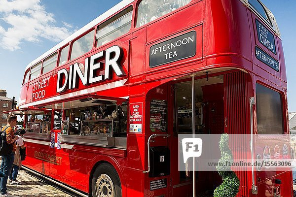 Routemaster bus converted into street cafe diner restaurant facility. Liverpool albert docks. Tourism in Merseyside England UK.