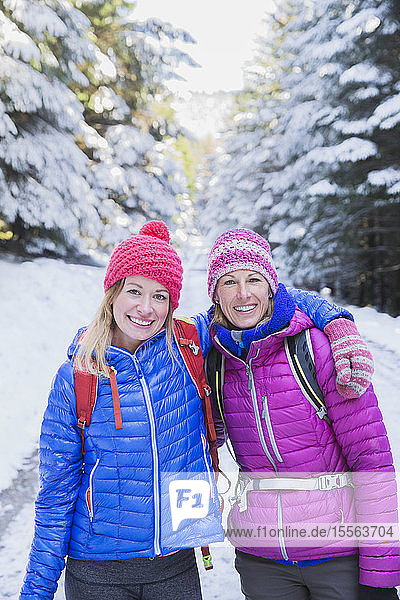 Portrait women hiking in snow